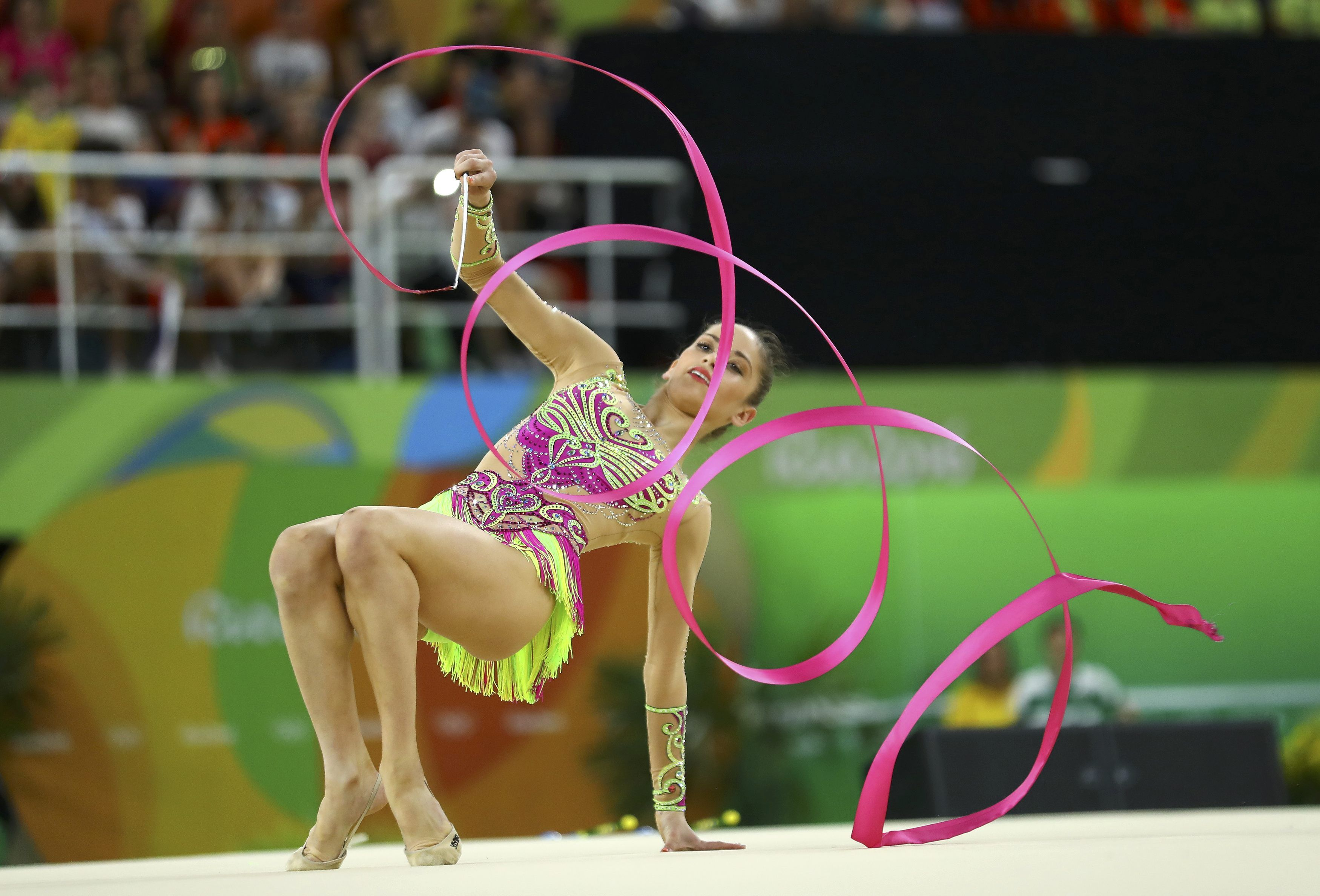 2016 Rio Olympics - Rhythmic Gymnastics - Preliminary - Individual All-Around Qualification - Rotation 4 - Rio Olympic Arena - Rio de Janeiro, Brazil - 19/08/2016. Neviana Vladinova (BUL) of Bulgaria competes using the ribbon. REUTERS/Mike Blake FOR EDITORIAL USE ONLY. NOT FOR SALE FOR MARKETING OR ADVERTISING CAMPAIGNS.